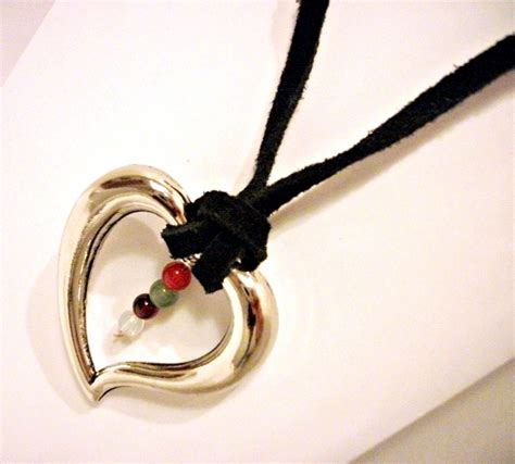 silver on leather necklace with healing