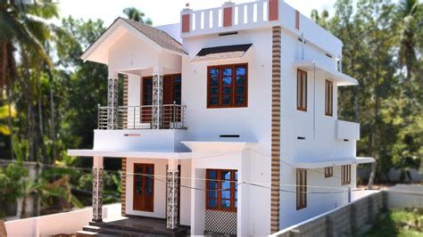 angamaly 4 5 cents plot and 1300 sq ft low budget house