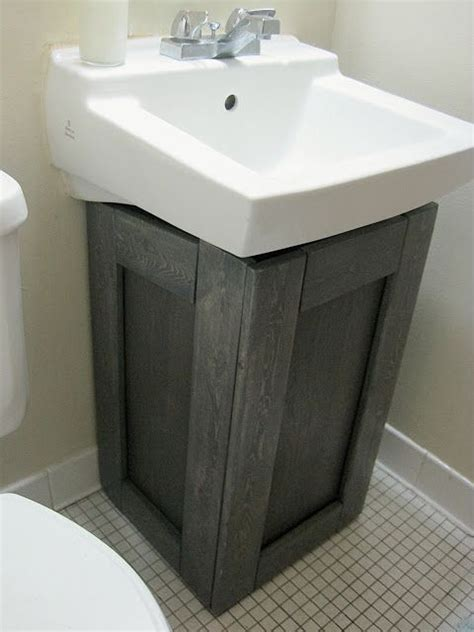 under bathroom sink cabinet the project lady fake wood cabinet to hide ugly pipes