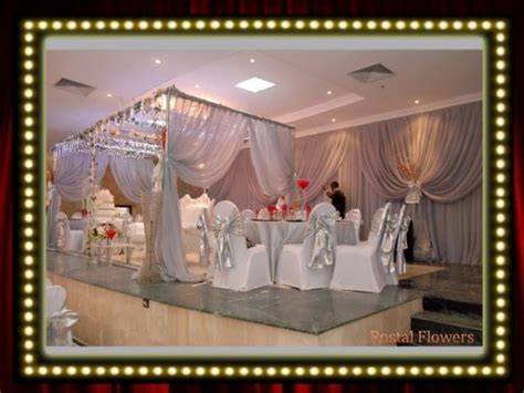 Bella Naija Wedding Decorations | presenting rostal flowers accessories centrepieces
