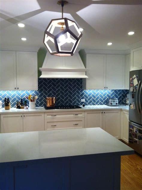 white cabinets blue backsplash blue herringbone backsplash island kitchen design