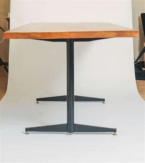 eames style dining table made of solid oak and black steel