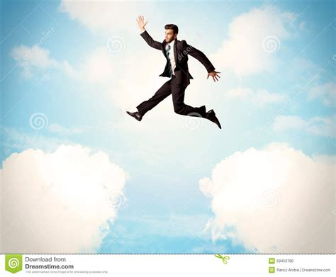 I Jumped On by Business Person Jumping Clouds In The Sky Stock Photo