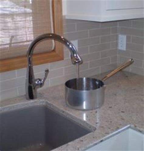 kitchen faucet placement clean clever on cleaning supplies recycling