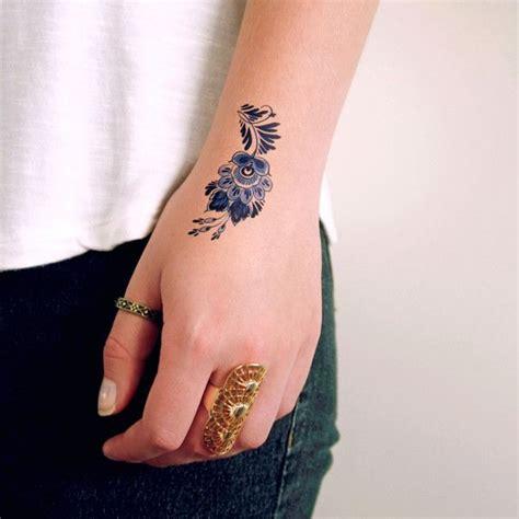 small blue tattoo best 25 delicate flower ideas on
