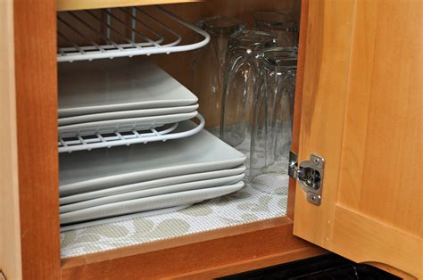 kitchen sink cabinet liner adding a decorative touch to the cabinets with duck brand