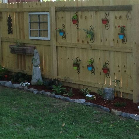 Backyard Fence Decorating Ideas 74 Best Images About Fence Decor On Pallet Garden Walls Birdhouses And Fence Post Caps