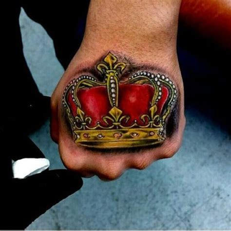tattoo hand crown 21 cool crown tattoo ideas for men styleoholic