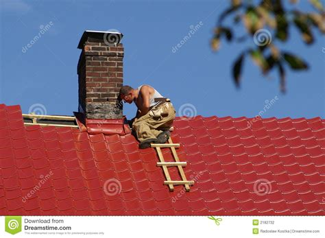 on the roof man on the roof stock photo image of hard metal