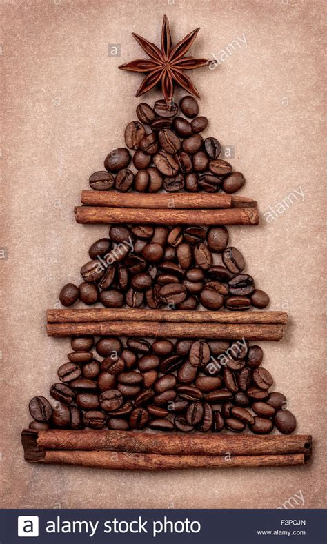 Retro Paper Christmas Decorations - christmas tree made of cinnamon sticks and coffee beans star anise stock photo royalty free