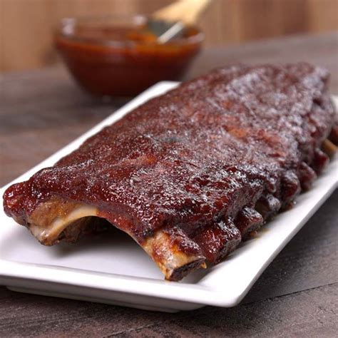 How Do You Bake A Rack Of Ribs by Baked Bbq Ribs With Rub Bbq Sauce Recipe Tiphero