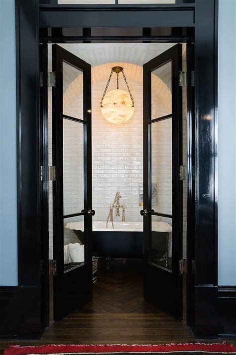 bathroom french doors black french doors open to black claw foot tub