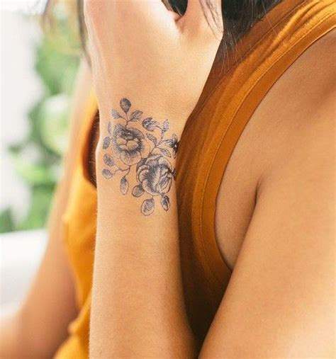 april tattoos designs 17 best ideas about flower wrist tattoos on