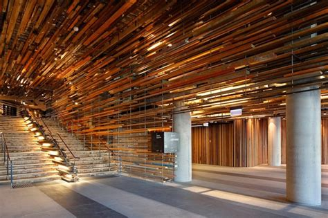 2 000 Pieces Of Reclaimed Wood Form A Textured Ceiling Wmarch Architectural Design Studio