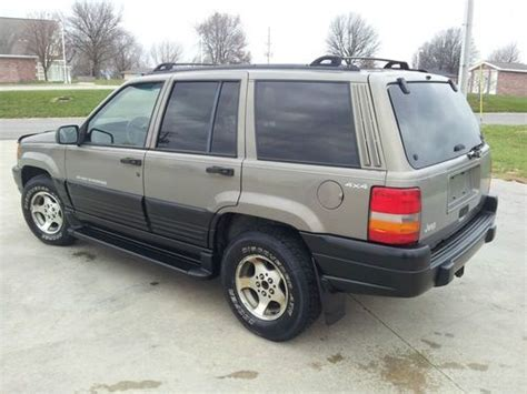 purchase used 1997 jeep grand laredo 4 0l 6 cyl new paint no reserve great deal in