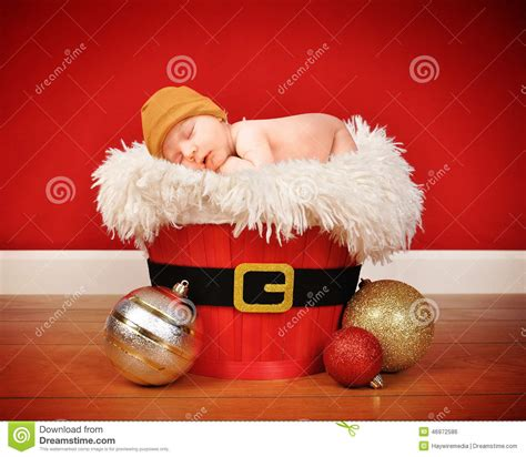 red santa sack for babies pictures baby sleeping in santa basket stock photo image 46972586
