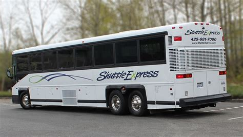couch buses 55 passenger coach bus from shuttle express