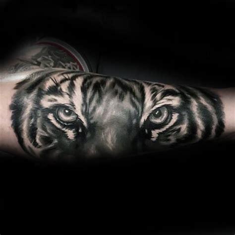 tiger eyes tattoo designs grey ink realistic tiger eye on forearm 1