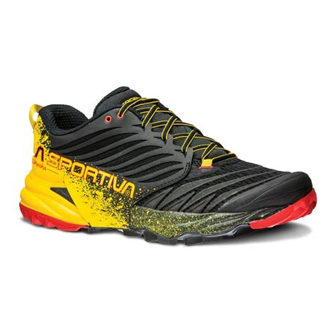 trail running shoes on road the la sportiva akasha in black and yellow at