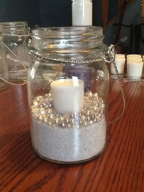 wedding diy   mason jars, candle, sand and pearls. Can
