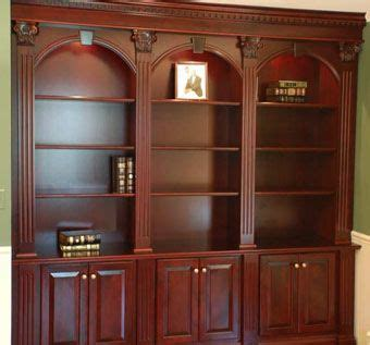 hand  ornate cherry bookcases  artisan custom