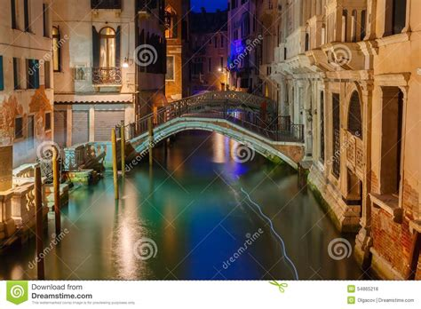 canal sound and light night lateral canal and bridge in venice italy stock