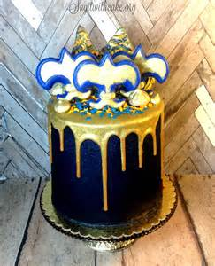 blue and gold boy scout cake with gold ganache say it with cake