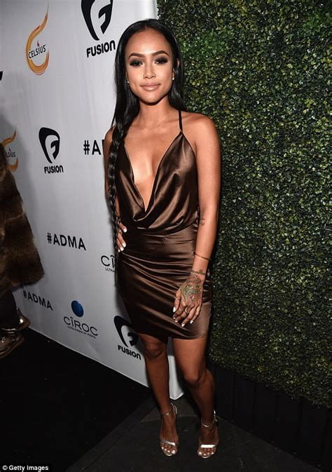 karrueche tran shows cleavage in plunge front bodysuit at 2014 grammys karrueche tran shows off her sensational figure in a