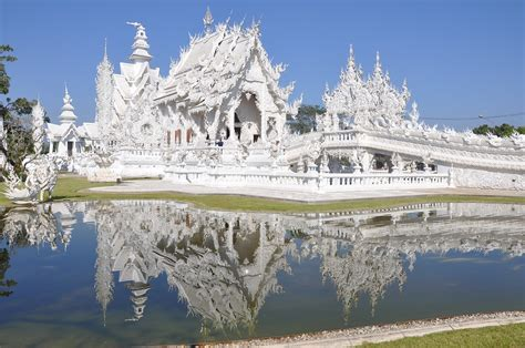 house insurance thailand the white temple and the black house bizzare buildings in chiang rai
