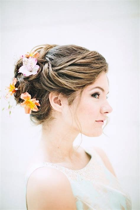 Tropical Wedding Hairstyles by Picture Of Wedding Updo With Tropical Blooms In It