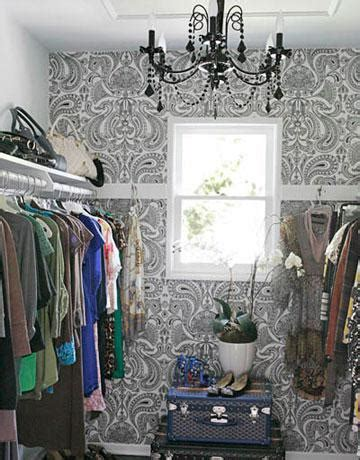 wallpaper in a closet inspiration and ideas closet dressing room crystal chandelier rug knobs light