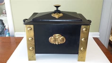 arts and crafts style wood or ash box in brass and steel