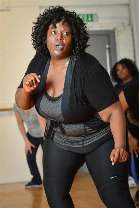 Obese fitness instructor teaches aerobics classes to help