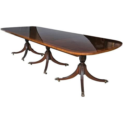 Georgian Style Crotch Mahogany And Satinwood Banded Triple Georgian Dining Table