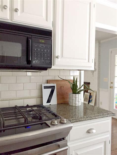 No Backsplash In Kitchen our white kitchen cabinets granite emily a clark