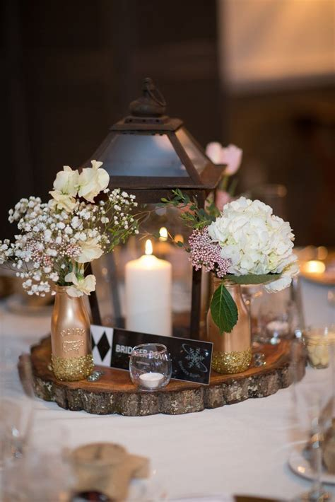 Rustic Lantern and Tree Trunk Centerpieces   Kathleen
