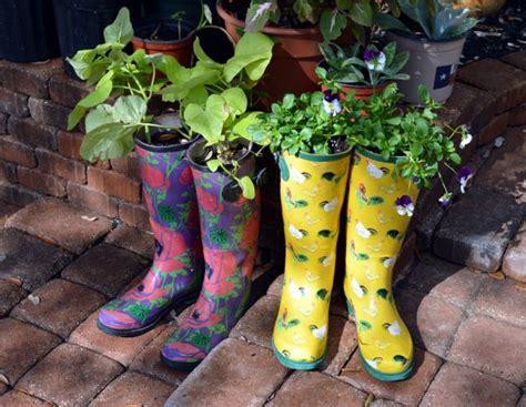 super creative ideas  repurpose rain boots  planters