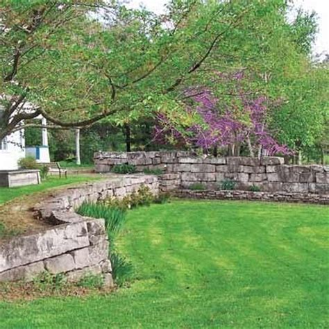 sloped backyard retaining wall sloped yard retaining wall back porch yard ideas