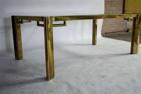 mastercraft expandable brass and glass dining table for