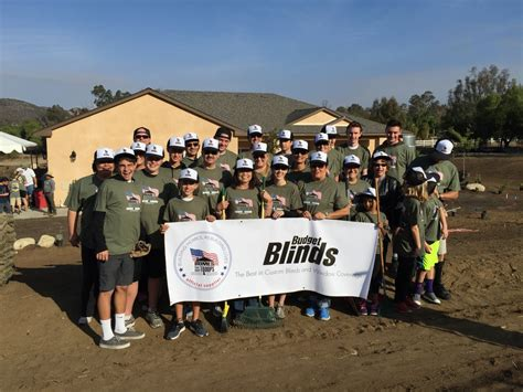 corporate staff participates in volunteer day for homes