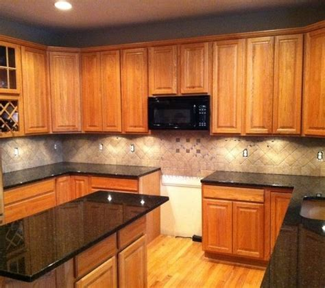 kitchen colors with oak cabinets and black countertops tile backsplash granite countertop oak colored