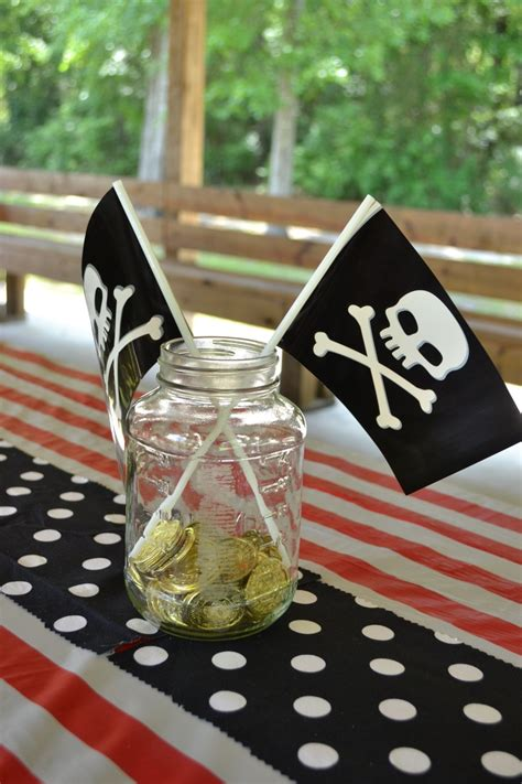 pirate party mason jar centerpieces with gold coins and