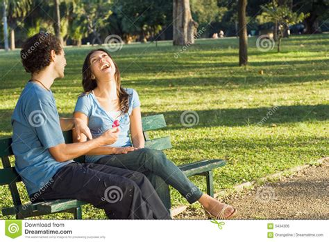 couple on park bench laughing couple on a park bench horizontal royalty free