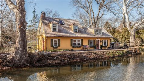 Country Cottage Homes For Sale by Enchanting Pumpkin Seed Cottage Along The Canal Seeks