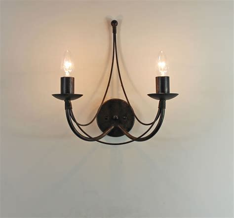 Wrought Iron Wall Lights The Tinwell Candle Wrought Iron Wall Light