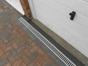 Patio Channel Drain by Channel Drain On Backfalling Driveway To Stop Water From