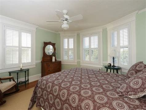 seafoam green walls bedroom white trim and plantation shutters seafoam green walls and brown accents make this