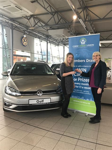 members draw winner collects  car core credit union
