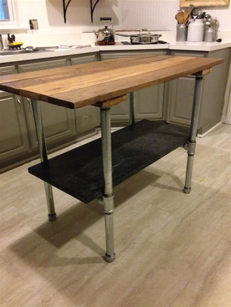 kitchen island tables products i love pinterest reclaimed barn door made into a kitchen island with a