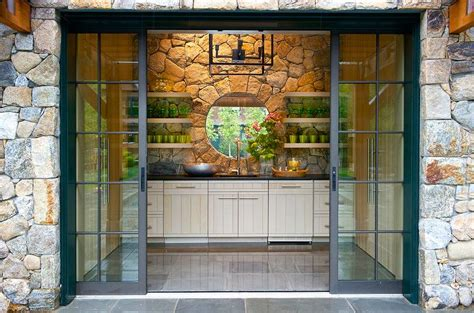 kitchen backsplash with patio doors 28 images exterior stone pool house with fireplace and teak chairs